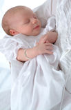 In Mother's Arms. A baby sleeping in mother's arms Stock Photos
