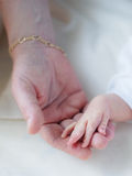 Mother's and baby's hands Stock Images