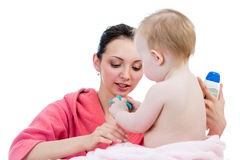 Mother's care after bathing to baby girl Stock Images