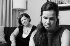 A mother's concern. Image of a mother looking concerned for her daughter Stock Image