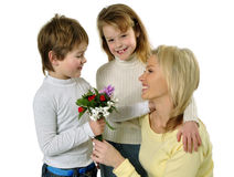Mother's day. Son giving flowers to his mom on mother's day Royalty Free Stock Photos