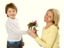 Mother's day. Son giving flowers to his mom on mother's day Royalty Free Stock Images