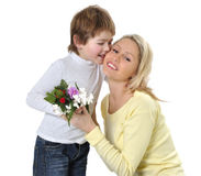 Mother's day. Son giving flowers to his mom on mother's day Stock Images