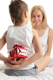 Mother's Day. Son gives to mum a gift royalty free stock photography