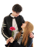 Mother's day. Son giving flowers to his mom on mother's day Royalty Free Stock Image