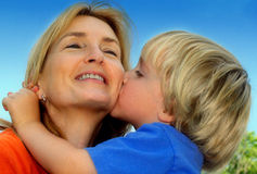 Mother's Day. Young boy and his mother share a joyful moment Royalty Free Stock Images