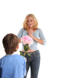 Mother's day. Son gives to mum a flower stock images