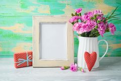 Mother`s day background with photo frame, flowers, heart shape and gift box stock photos
