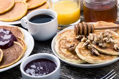 Mother`s day brunch with  delicious pancakes with honey and nuts. Orange juice and cup of coffee Stock Image