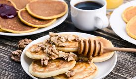 Mother`s day brunch with  delicious pancakes with honey and nuts. Orange juice and cup of coffee Stock Images