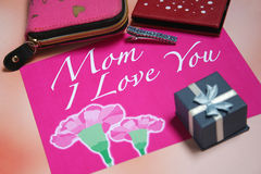 Mother's Day Card. Pink Mother's Day card with love message & carnation and purse Stock Photography
