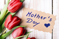 Mother's Day card and a bouquet of beautiful tulips Stock Images