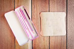 Mother's Day card with box pencils on a wooden board. Stock Photos