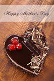 Mother`s day chocolate cake in shape of heart. With inscription I love you Mom stock photo