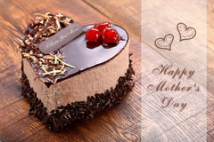 Mother`s day chocolate cake in shape of heart. With inscription I love you Mom Stock Images