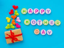 Mother`s day concept. HAPPY MOTHER DAY. Alphabet with colorful heart and gift on blue background stock photos