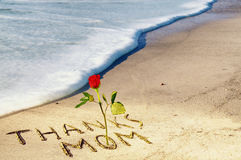 Mother`s day concept on sand. Thanks mom concept on sand Royalty Free Stock Images