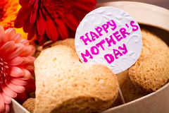 Mother`s Day cookie and flowers. Royalty Free Stock Images