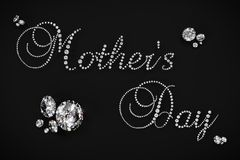 Mother`s Day 3D diamond render. Illustration of 3D diamonds in the shape of the words Mother`s Day rendered on a black background Stock Photography