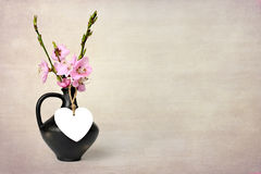 Mother's Day flowers in vase on grunge background Stock Photo