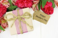 Mother's Day gift box with flowers on white wood Stock Photos