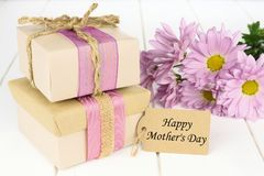 Mother's Day gift boxes with flowers and tag Royalty Free Stock Photos