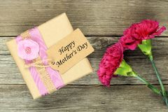 Mother's Day gift with carnations on wood Stock Photos