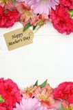 Mother's Day gift tag with flower frame on white wood Stock Photos