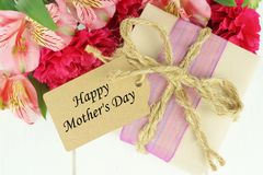 Mother's Day gift with tag and flowers Stock Image