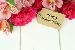 Mother's Day gift tag with flowers on white wood Stock Image
