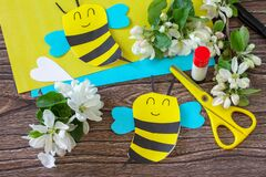Free Mother`s Day Greeting Card Gift - Bee With Spring Apple Tree Flowers On A Wooden Table. Childrens Creativity Project, Handmade, Stock Photography - 212818952