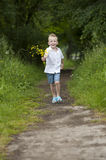 Mother's day : little boy with flowers , outdoors Royalty Free Stock Image