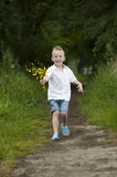 Mother's day : little boy with flowers , outdoors Stock Image