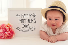 Mother`s Day massage with happy baby boy. With a pink flower Royalty Free Stock Photography
