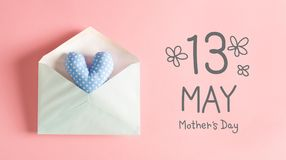 Mother`s Day message with a blue heart cushion. In an envelope stock photos