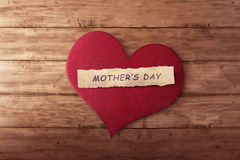 Mother`s day message on ripped paper in red heart shape Stock Photography