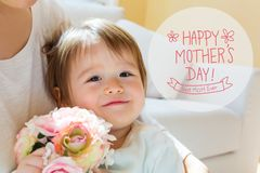 Mother`s Day message with toddler boy with his mother. Holding flowers royalty free stock images