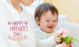 Mother`s Day message with toddler boy with his mother. Holding flowers royalty free stock photo