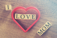 Mother's Day message. Written on wooden blocks royalty free stock image