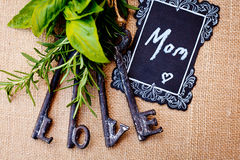 Mother`s Day - Mom with love keys. On burlap background Stock Image