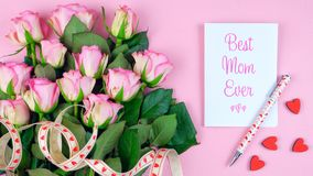 Mother`s Day overhead with roses, Best Mom Ever card and gift on pink table. Stock Photography