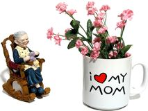 Mother's Day Sentiment. Mom mug with pink flower as 'mom' looks on stock photography