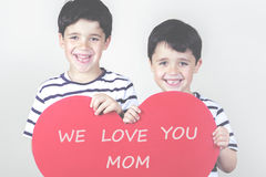Mother's Day. Smiling boys with a red heart for the Mother's Day Royalty Free Stock Photo