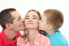 Mother`s Day. Son kissing and hugging her mother. Husband kisses. And hugs his wife. Close up Stock Photos