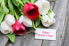 Mother's day. Tulips with tag and text for mother's day on wooden background
