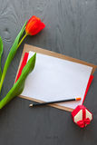 Mother`s Day, woman`s day.  tulips  ,letter and presents on wooden background Stock Photography