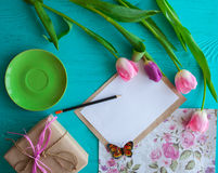 Mother`s Day, woman`s day. tulips ,presents and letter on wooden background Stock Photos