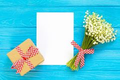 Mother`s day. Women`s day. Valentine`s day, Birthday greeting background. Lily of the Valley, envelope, packing gifts. Mother`s day. Women`s day. Valentine`s stock image