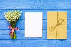 Mother`s day. Women`s day. Valentine`s day, Birthday greeting background. Lily of the Valley, envelope, packing gifts. Mother`s day. Women`s day. Valentine`s stock photos
