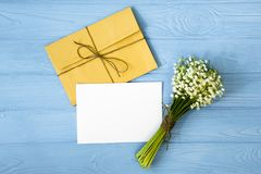 Mother`s day. Women`s day. Valentine`s day, Birthday greeting background. Lily of the Valley, envelope, packing gifts. Mother`s day. Women`s day. Valentine`s stock photo